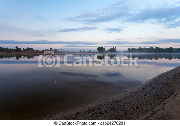 Clouds reflecting in the lake, Ukraine. - csp24270201