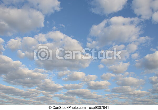 cloudy blue spring sky sun-lit background  - csp9307841