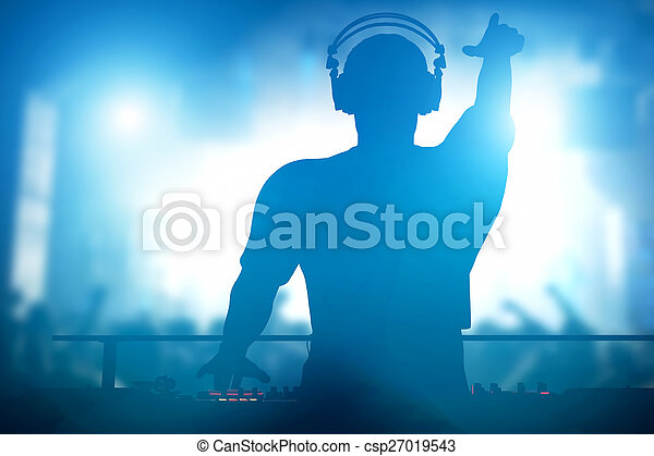 Club, disco DJ playing and mixing music for people. Nightlife - csp27019543