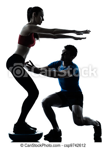 coach man woman exercising squats on bosu - csp9742612