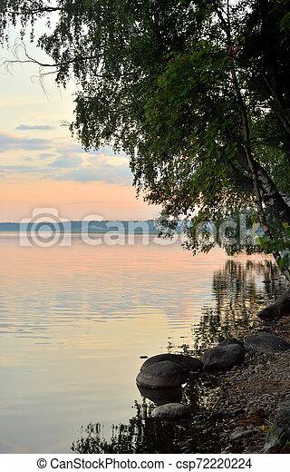 Coast of lake at summer evening. - csp72220224