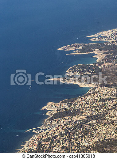 coastal aerial near Marseille with harbor under blue sky - csp41305018