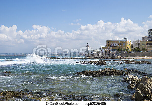 Coastline in Tyre at the ocean with waves and with lighthouse in Tyre, Sour, Lebanon - csp52025405