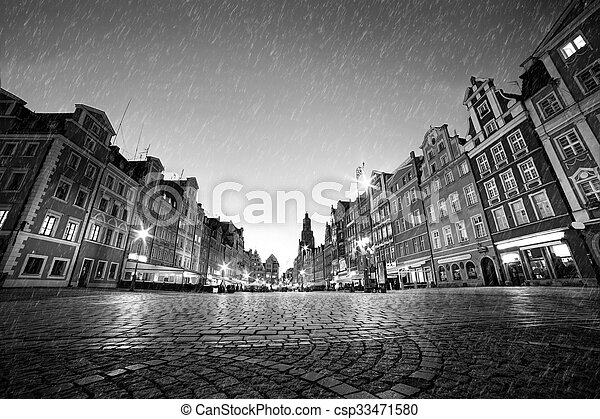 Cobblestone historic old town in rain at night. Wroclaw, Poland. Black and white - csp33471580