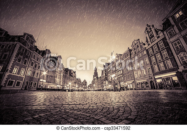 Cobblestone historic old town in rain at night. Wroclaw, Poland. Vintage - csp33471592