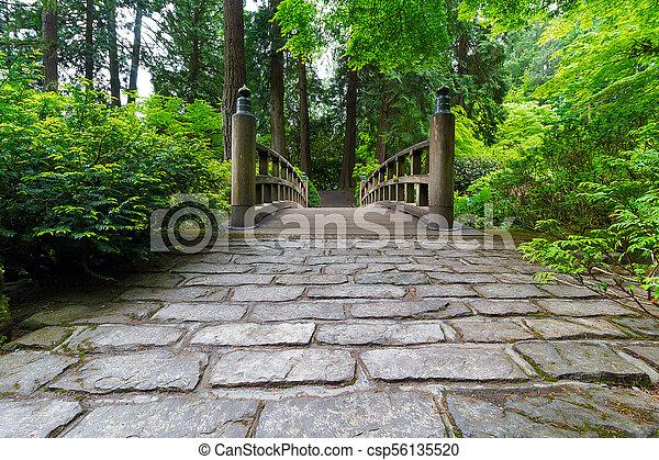 Cobblestone Path to Wood Bridge - csp56135520