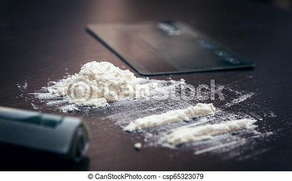 Cocaine powder on the table - csp65323079