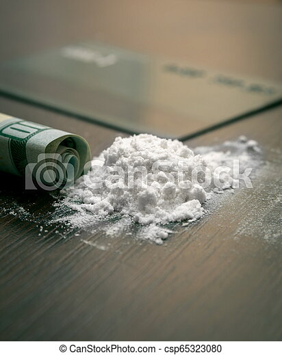Cocaine powder on the table - csp65323080
