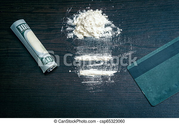 Cocaine powder on the table - csp65323060