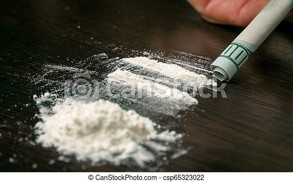 Cocaine powder on the table - csp65323022