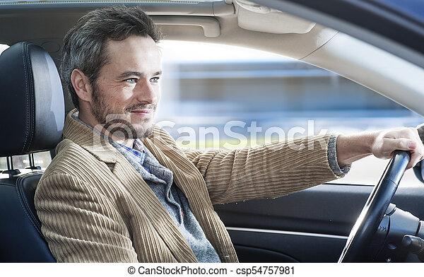 Un hombre guapo conduciendo un coche - csp54757981