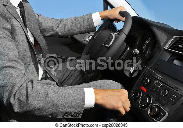Un joven vestido con un coche - csp26028345