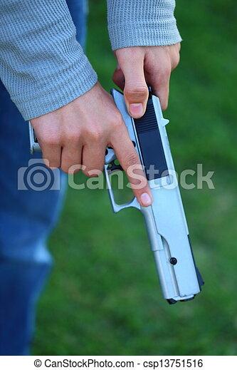 Cocking a Gun - csp13751516