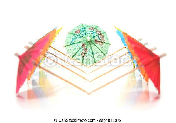 cocktail umbrellas in a row - csp4818872