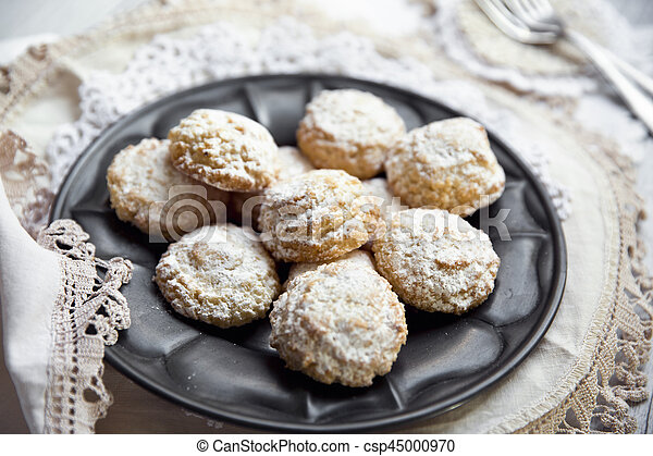 Coconut biscuits with icing sugar over pewter plate - csp45000970