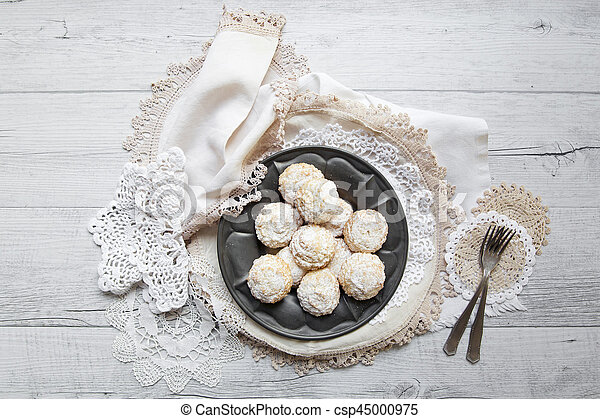Coconut biscuits with icing sugar over pewter plate - csp45000975