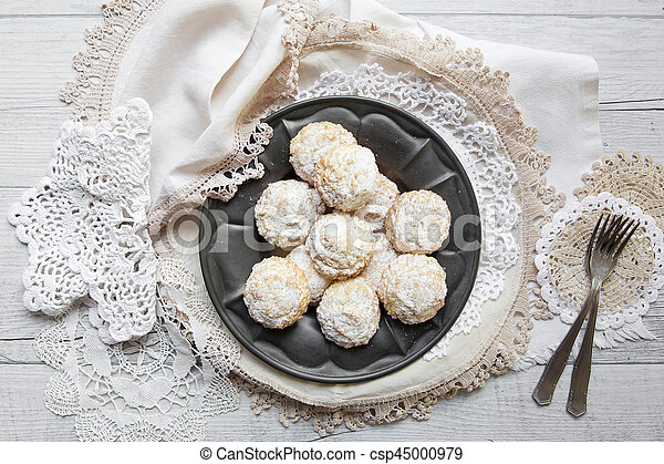 Coconut biscuits with icing sugar over pewter plate - csp45000979