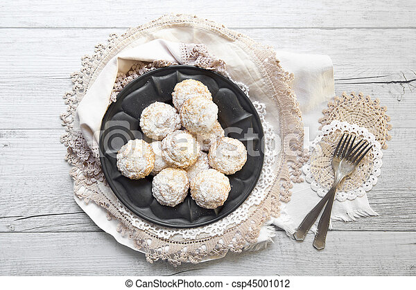 Coconut biscuits with icing sugar over pewter plate - csp45001012