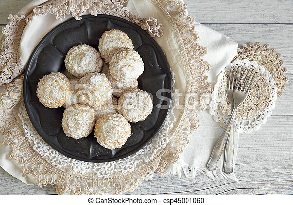 Coconut biscuits with icing sugar over pewter plate - csp45001060