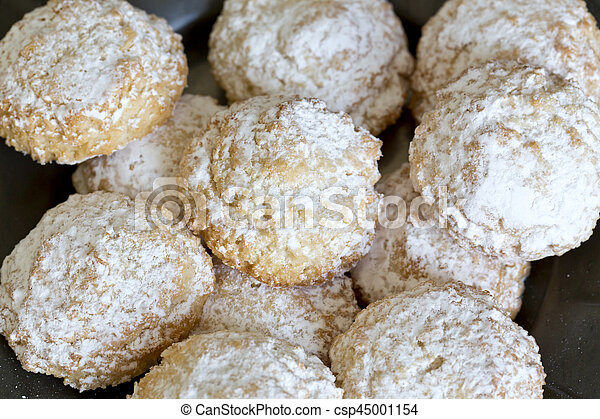 Coconut biscuits with icing sugar over pewter plate - csp45001154