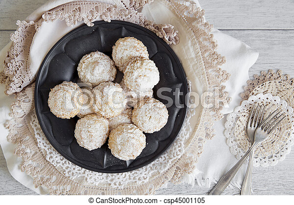Coconut biscuits with icing sugar over pewter plate - csp45001105