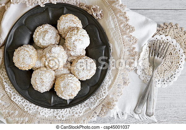Coconut biscuits with icing sugar over pewter plate - csp45001037