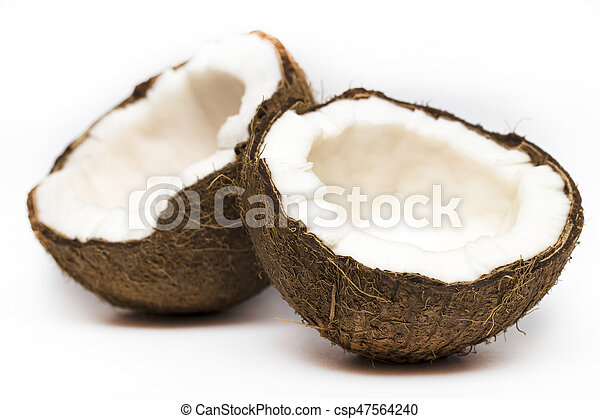 Coconut with a half on white background, closeup - csp47564240