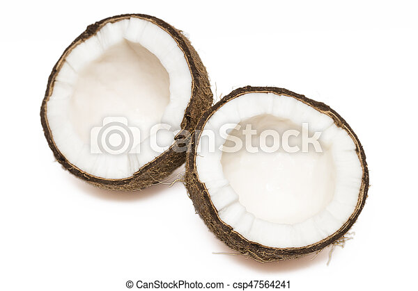Coconut with a half on white background, closeup - csp47564241