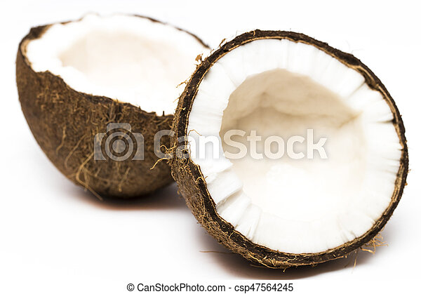 Coconut with a half on white background, closeup - csp47564245