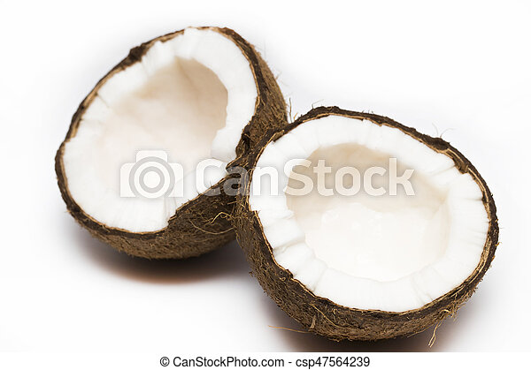 Coconut with a half on white background, closeup - csp47564239