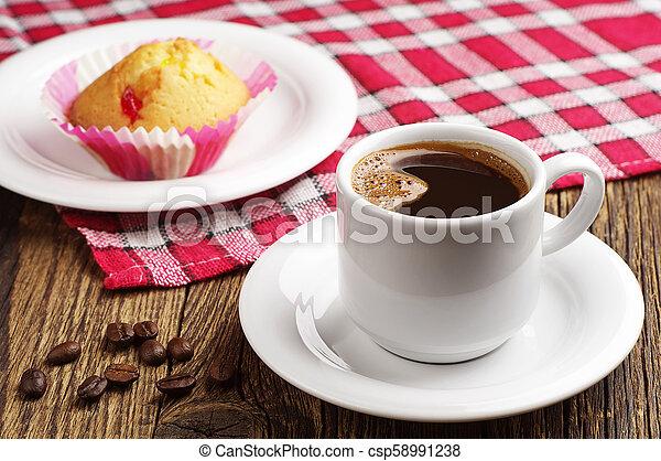 Coffee and cupcake - csp58991238