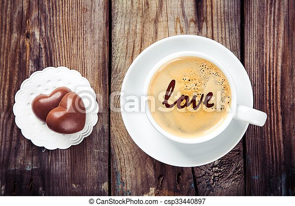coffee and heart chocolates - csp33440897