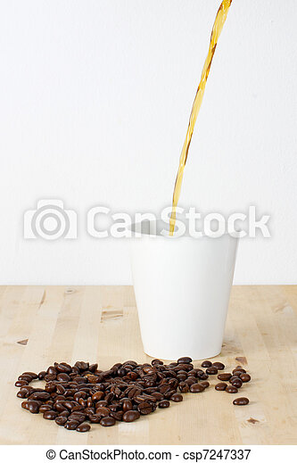 Coffee beans and cup 2 - csp7247337