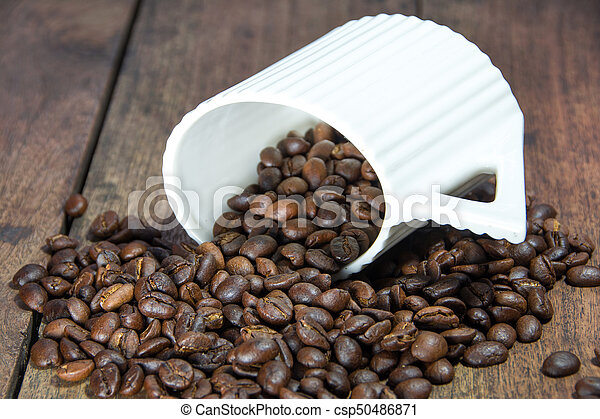 Coffee beans in cup - csp50486871
