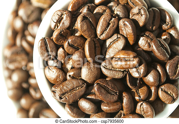 Coffee beans in cup  - csp7935600