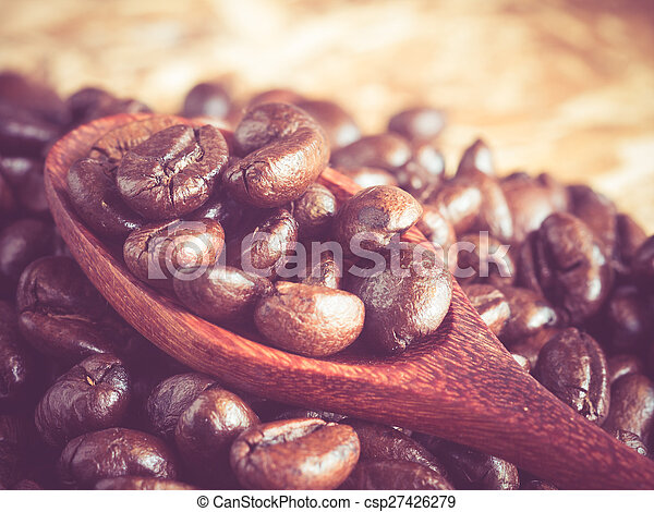 Coffee beans in wooden spoon with filter effect retro vintage style - csp27426279