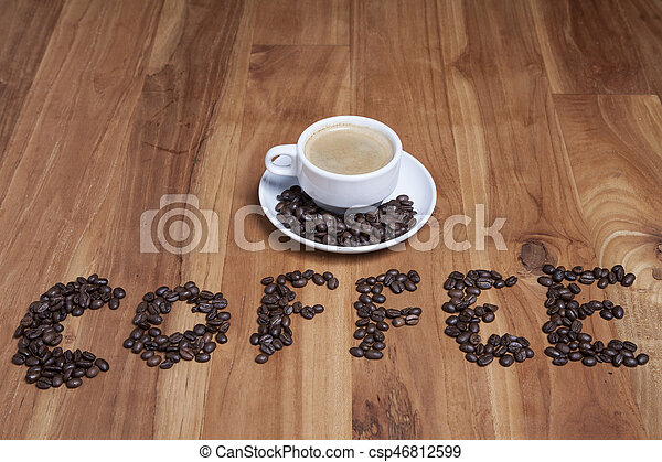 coffee beans on the wood table - csp46812599