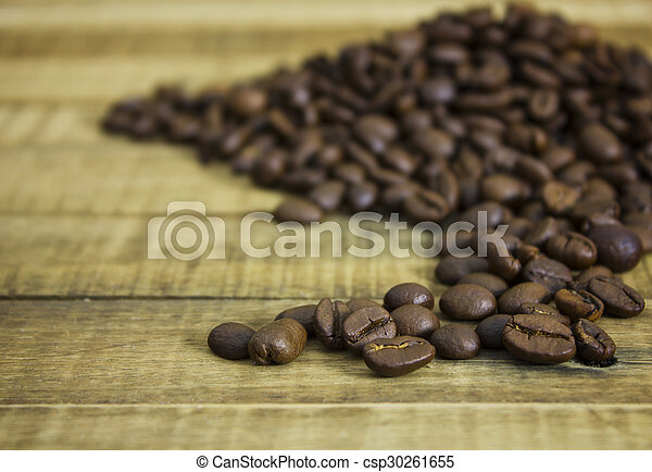 coffee beans on the wooden table background - csp30261655
