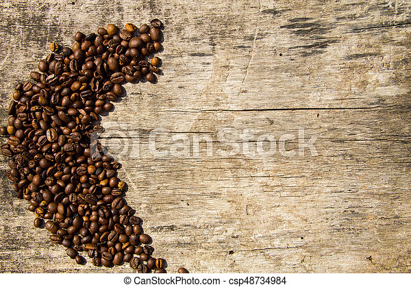 Coffee beans on wooden background - csp48734984