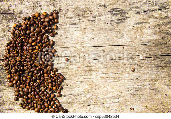 Coffee beans on wooden background - csp53042534
