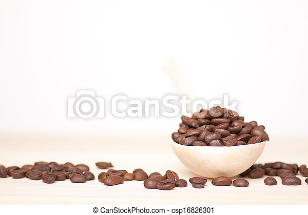coffee beans on wooden surface - csp16826301