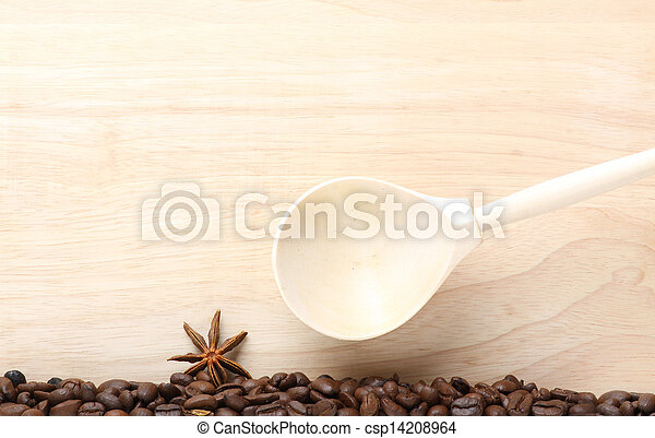 coffee beans on wooden table with wooden spoon - csp14208964