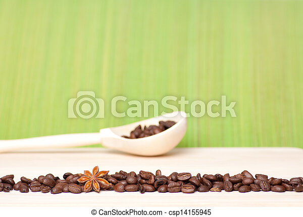 coffee beans on wooden table with wooden spoon - csp14155945