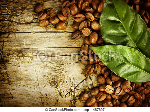 Coffee Beans over Wood Background - csp11467697