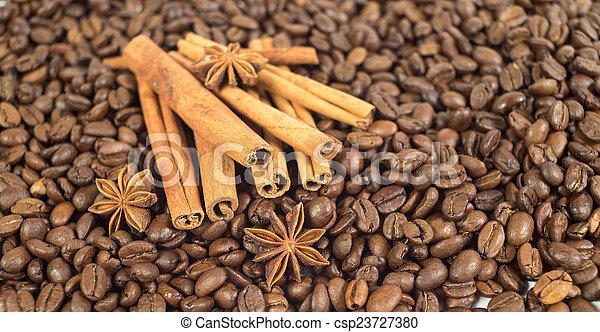 Coffee beans. Three anise stars. Lots of sticks of cinnamon. Sha - csp23727380