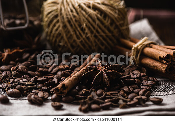 Coffee beans with autumn spices on the tablecloth. - csp41008114