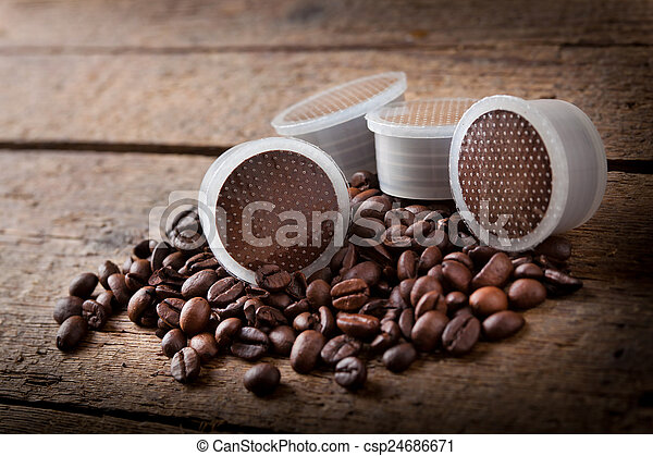 Coffee beans with pods. - csp24686671