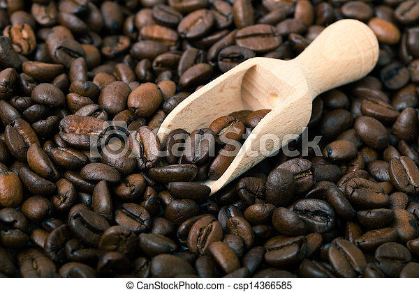 Coffee beans with wooden spoon - csp14366585