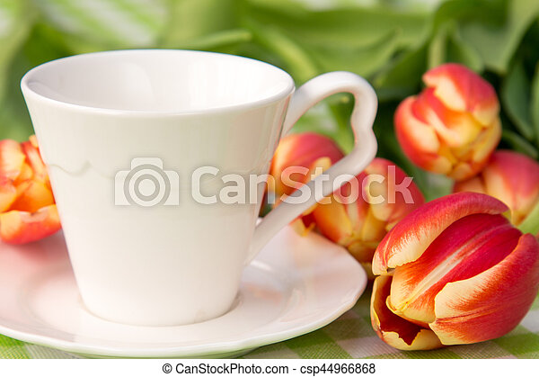 Coffee cup and bunch of tulips - csp44966868