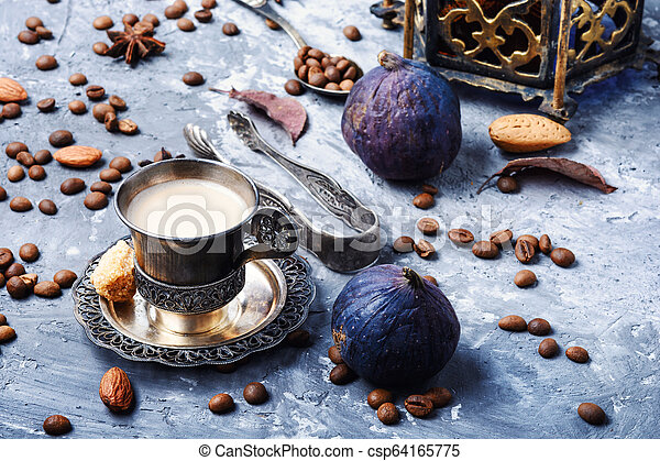Coffee cup and coffee beans - csp64165775